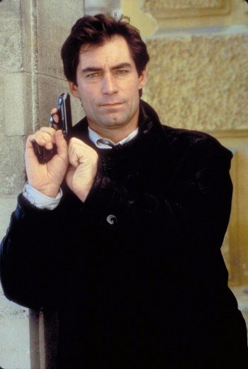 Timothy Dalton as James Bond in The Living Daylights (1987). Note his shirt's adjustable barrel cuff visible under the sleeve of the sweater.