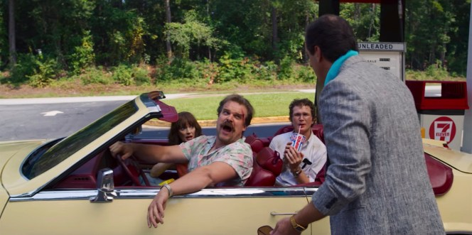 """Hop allows himself a """"Magnum moment"""" as, clad in an Aloha shirt, he speeds out of a parking lot in a luxurious convertible."""