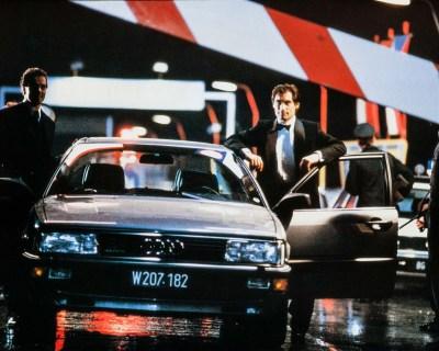 Saunders and Bond stand astride Station V's Audi 200 quattro sedan.