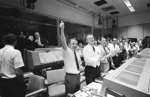Gene Kranz (center, in white vest) celebrates Apollo 13's successful splashdown on April 17, 1970.