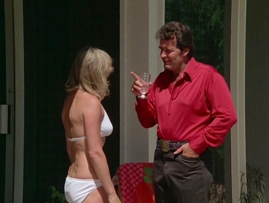 """Accessorized with his oilman's belt and buckle, Rockford confronts Audrey as she continues spinning her web of deception in """"The Farnsworth Strategem"""" (Episode 2.02)."""