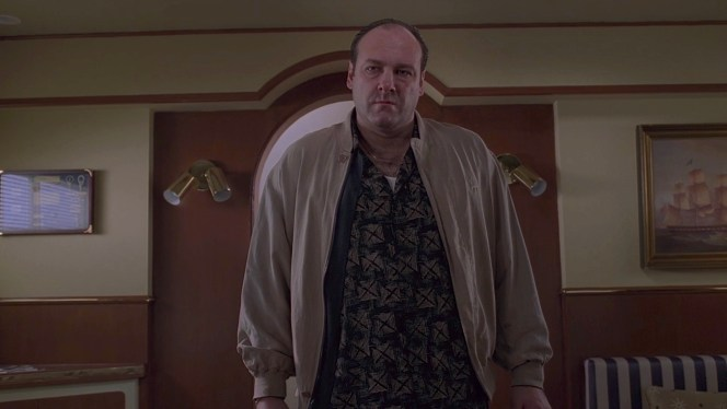 """Tony's beige bomber-inspired jacket should have tipped Pussy off that an execution was afoot; the last time Tony wore this type of jacket was during Matthew Bevilacqua's execution in """"From Where to Eternity"""" (Episode 2.09) when he sported an olive drab suede-like bomber."""