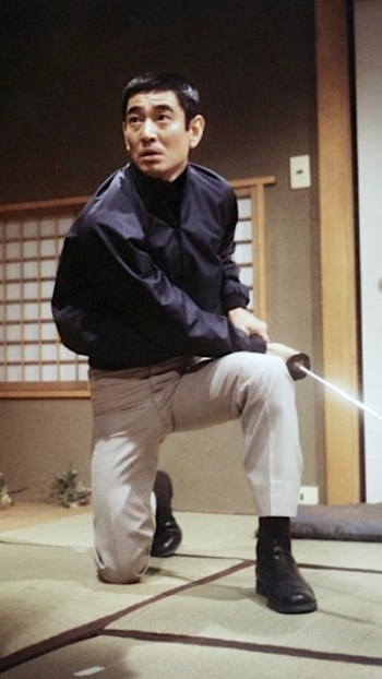 Ken Takakura as Ken Tanaka in The Yakuza (1974)