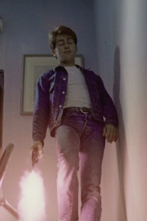 Kit fires a round from his Hi-Standard Sentinel into the floor to demonstrate to Holly's father that he means business.