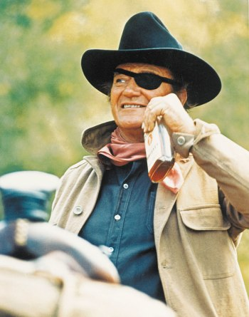 "John Wayne as Reuben ""Rooster"" Cogburn in True Grit (1969)"