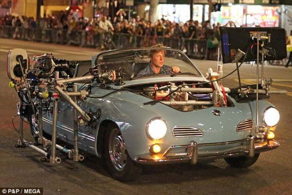 Brad Pitt behind the wheel of Cliff Booth's camera-rigged Karmann Ghia during production of Once Upon a Time in Hollywood. (Photo source: P&P MEGA)
