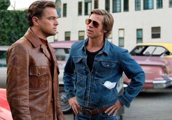 Production photo from Once Upon a Time in Hollywood with Brad Pitt prominently wearing Cliff's vintage Wrangler zip-up denim jacket. Less prominently seen in this particular photo are Leonardo DiCaprio's trousers, which are also a vintage Wrangler product.