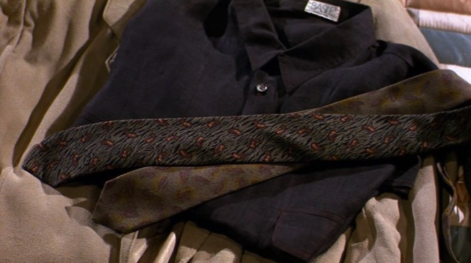 Note Basile's distinctive tag sewn against the neckband of his purple shirt. The Italian brand's logo has remained unchained in the 40 years since American Gigolo was released.
