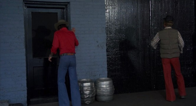 Each clad in their respective bellbottoms, the Bandit and Snowman try to gain access to the Coors storage facility.