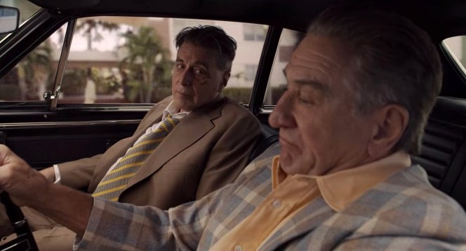 Jimmy and Frank debrief during the ride home after the meeting takes a sour turn. While Frank's plaid sports coat and open-neck shirt may not align with the Mandated Jimmy Hoffa Meeting Dress Code, the Irishman likely gets a pass as his garb shares considerably more in common with traditional businesswear than Tony Pro's printed shirt and shorts.