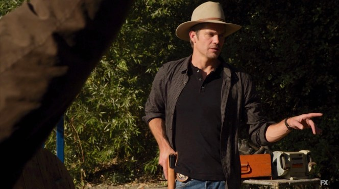 Raylan wisely keeps one hand on his holster.