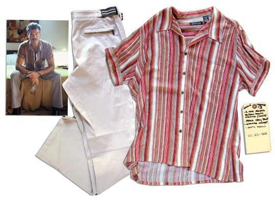 Pierce Brosnan's screen-worn striped Kenneth Cole shirt and pale gray elastic-belted Prada trousers, as auctioned by Nate D. Sanders.
