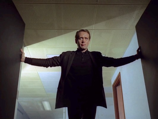 Number 6 returns to his office to make his dramatic resignation, depicted in the opening credits of nearly every episode.