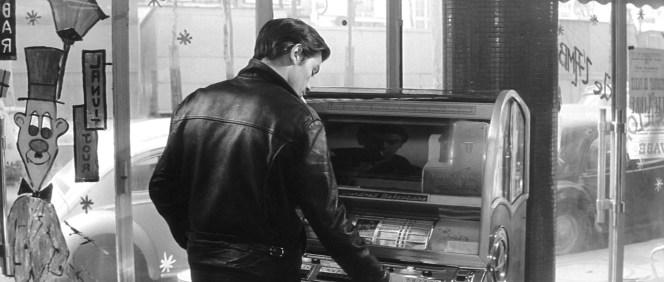 Francis works the jukebox.