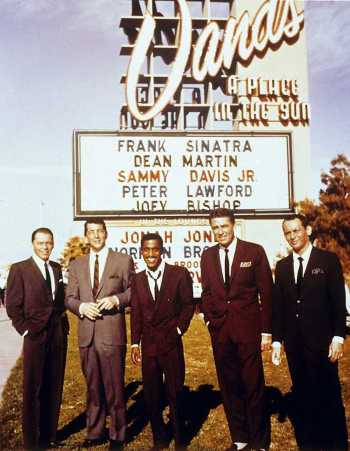 Frank Sinatra, Dean Martin, Sammy Davis Jr., Peter Lawford, and Joey Bishop in front of the Sands in Las Vegas during production of Ocean's Eleven (1960)