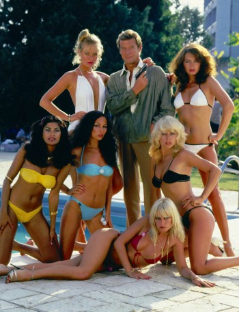 Roger Moore as James Bond, flanked by Lizzie Warville, Alison Worth, Viva, Vanya, Kim Mills, and Laila Dean, in For Your Eyes Only (1981)