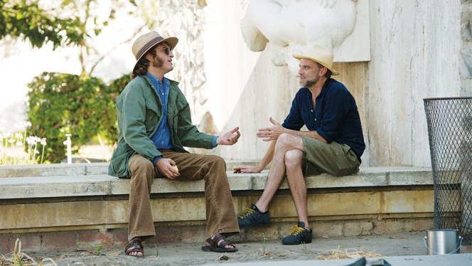 Joaquin Phoenix and Paul Thomas Anderson during production of Inherent Vice (2014)