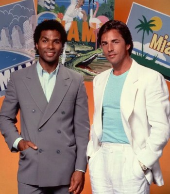 Philip Michael Thomas and Sonny Crockett promoting Miami Vice, each wearing a suit that would be featured in the pilot episode, albeit not at the same time.
