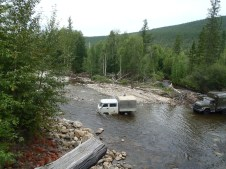 BAM stuck van in river.