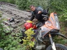 Mark's bike fallen through old bridge!