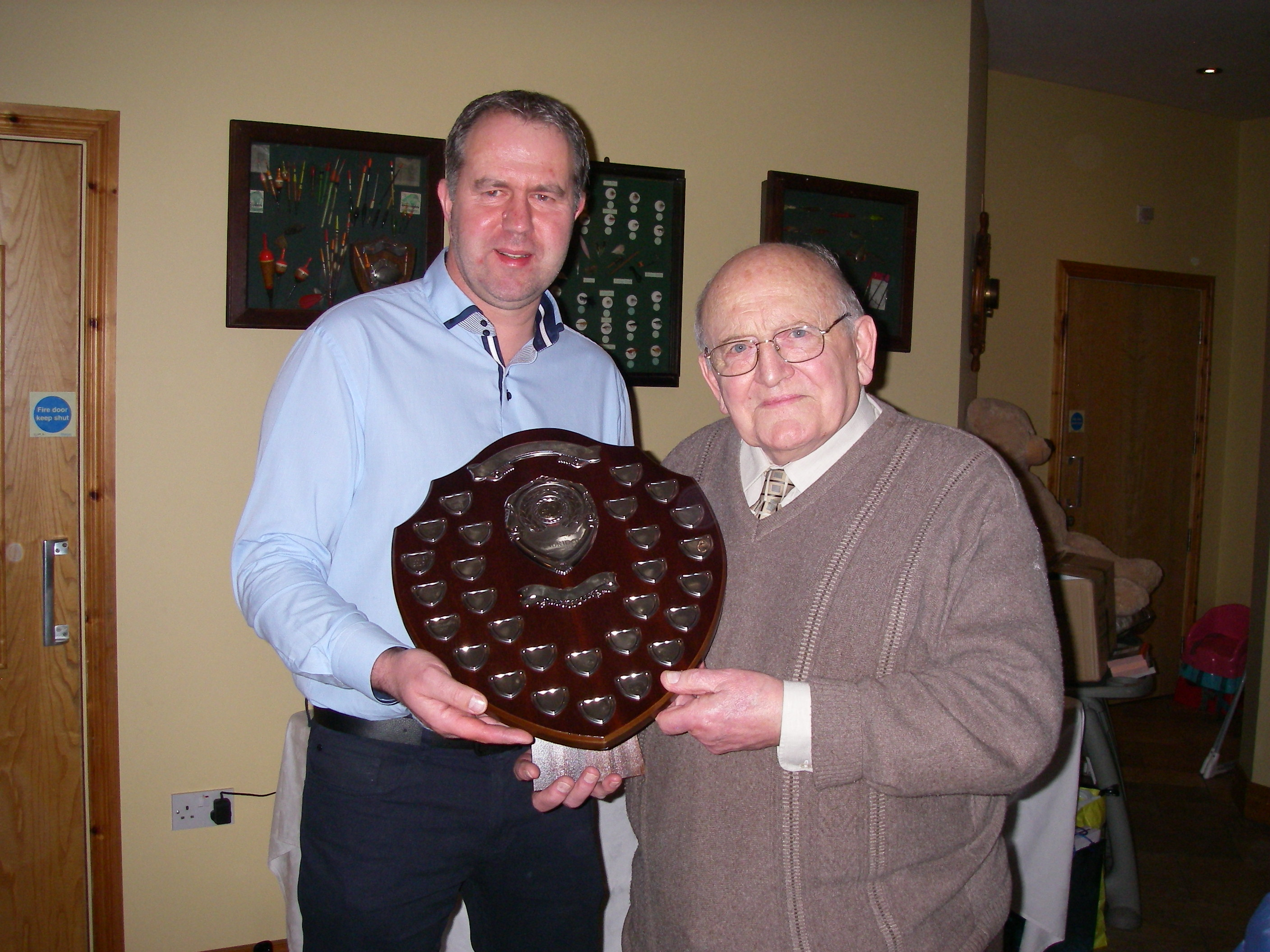 BAC Roger McClements, Angler of the Year 2017 is presented with the Angler of the Year Shield by Sam Vage, Club President