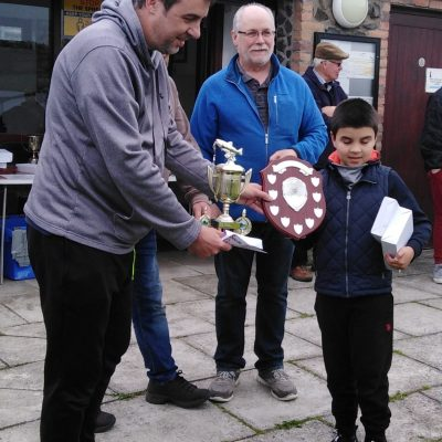BAC - The Junior Angler of the Year 2020 receives his trophies from Sam Watt, Chairman at the Corbet Lough on Thursday 27 May 2021