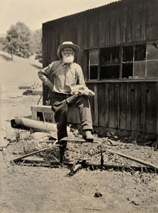 Exhibit item: C. HART MERRIAM PICTORIAL COLLECTION, 'Hiram Kennedy (age 82) with Bear Trap,' Long Valley, Calif. July 31, 1917. Photo by S.W.B. Stephens