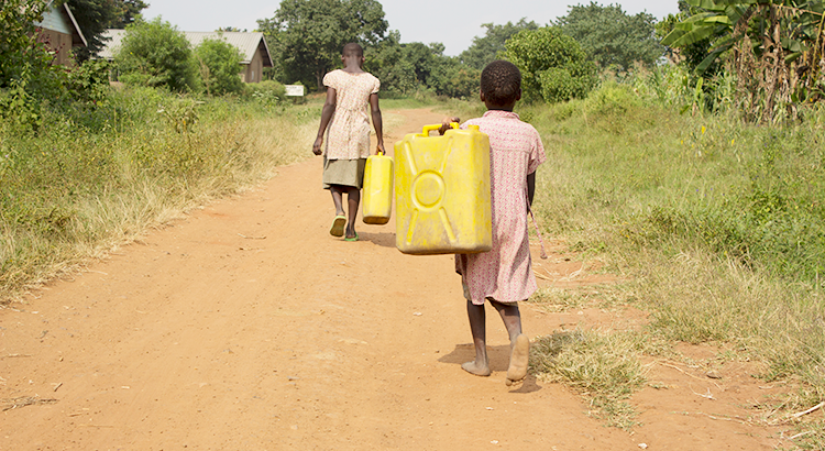 Children (Jackie and Shanita) on their way to get water
