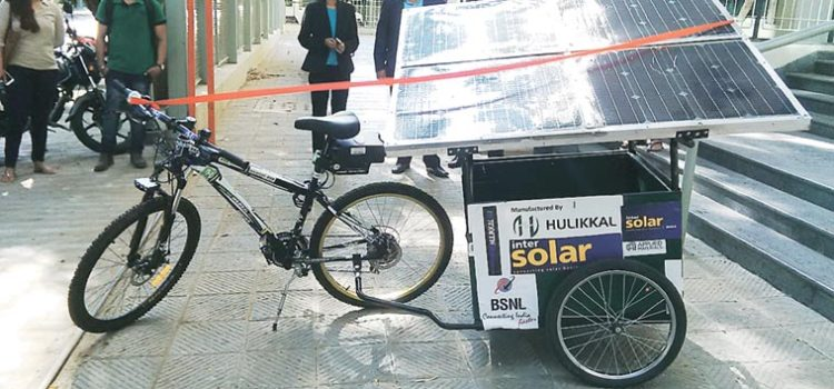 Solar bicycle ride in the city by an Engineer :