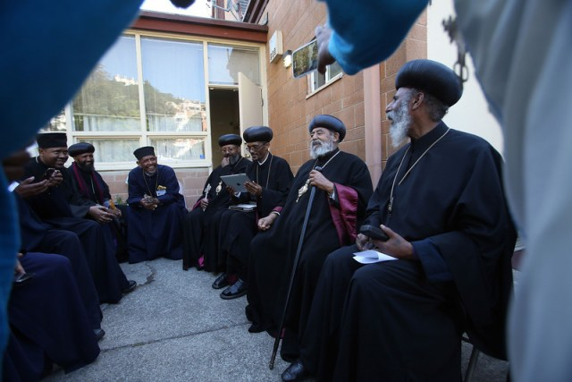 Ethiopian Bishop Abune Melketsedek, of Oakland, second from right, and Bishop Elias, of Sweden, right, socialize with other bishops and priests during their 39th Holy Synod meeting at the Ethiopian Orthodox Tewahedo Mekane Selam Medhane Alem Cathedral in Oakland, Calif., on Friday, May 16, 2014. Bishops and priests from the U.S. and abroad gathered in Oakland last week to resolve internal differences within the Ethiopian Orthodox Church, and hoping to sustain the church's following among the next generation of Ethiopian-Americans. Melketsedek heads the Oakland church. (Jane Tyska/Bay Area News Group)