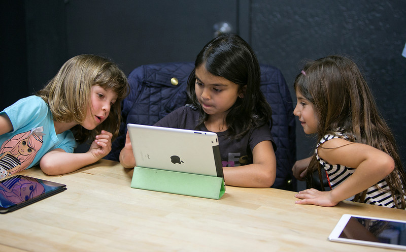 From left, Anna Heath, 5, Aryka Gunsagar, 6, and Rayah Ghosheh, 6, test Kidaptive's Leo's Pad app at the Kidaptive office in Palo Alto, Calif., on Wednesday, May 7, 2014.  (LiPo Ching/Bay Area News Group)