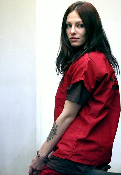 Alix Tichelman looks back toward her family in Department 3 of Santa Cruz County Superior Court as she leaves her arraignment on Wednesday. (Shmuel Thaler/Santa Cruz Sentinel)