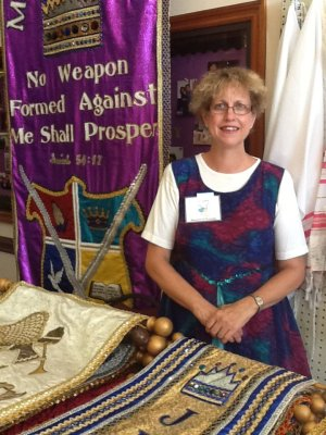 linda-and-banners-of-worship-booth