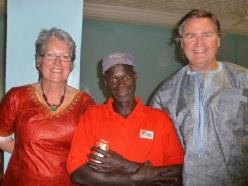 Colin & Heather Acheson in the traditional Gambian outfits which they were presented
