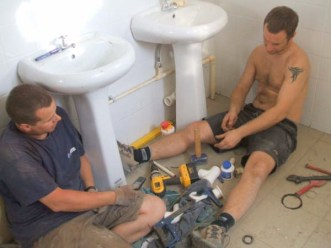 Fitting hand basins in the male toilet block