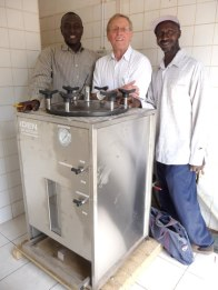 The new autoclave funded by the Rotary Club of Norwich (Sulayman, Chris & Bunja)