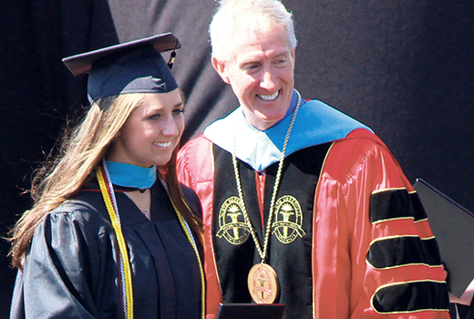 Mary Lee Bailes receives her degree from NGU president Jimmy Epting.
