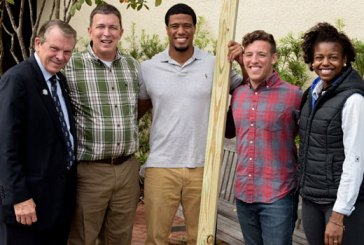 SCBC president Tommy Kelly, second from left, visits with Charleston Southern students and CSU president Jairy C. Hunter after chapel service.