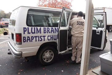 Inmates help unload 550 prisoner packets from Edgefield Baptist Association that were delivered by the Plum Branch Baptist Church van to the collection site in Columbia.