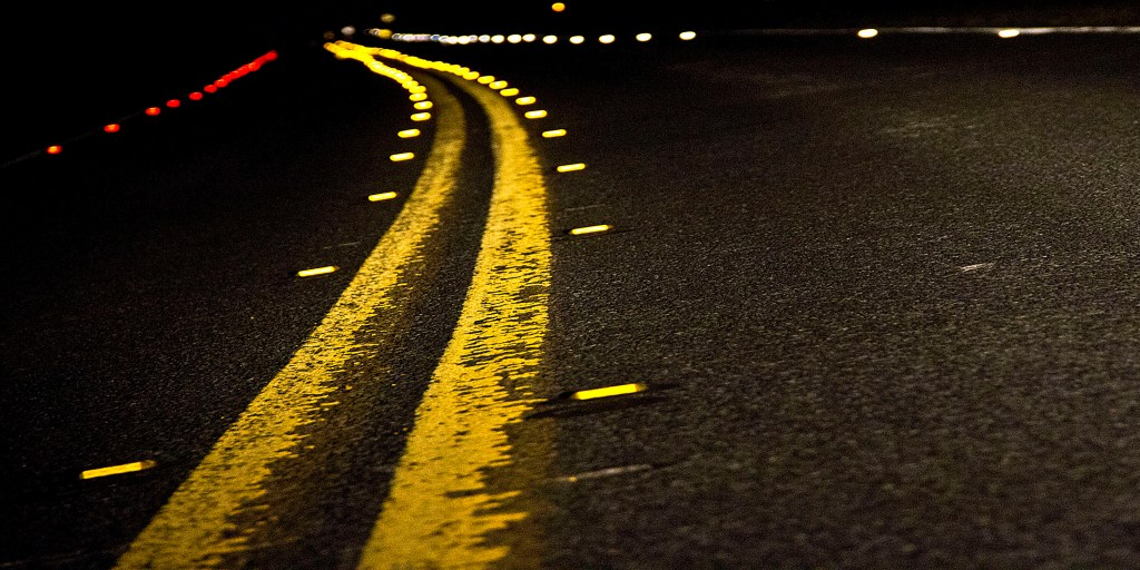 Depth captured image of long narrow road and yellow lines