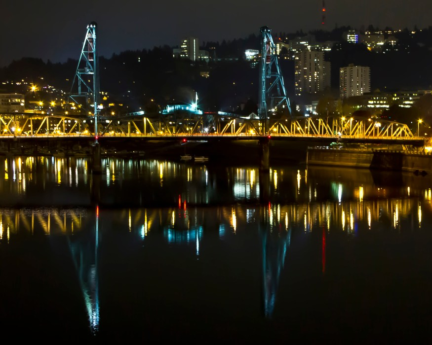 Reflection on Willamette River of Steel Bridge in downtown Portland Oregon