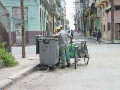 Black Cubans Look For Food In Garbage