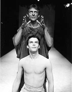 A Young Iain Deane Kneeling In Front Of Famous Actor Jeremy Brett