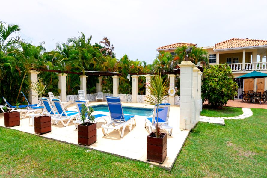 Palm Villa Barbados pool, sunbathing terrace and outdoor eating area