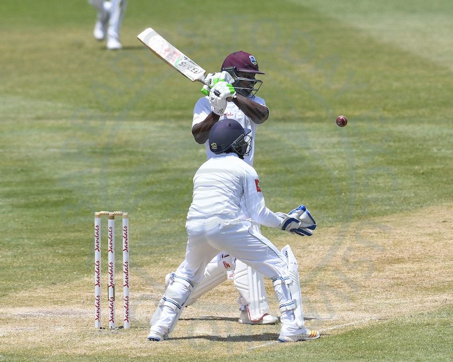 Opener Devon Smith pulls during his unbeaten half-century in today's rain-hit second day of the second Test in St Lucia