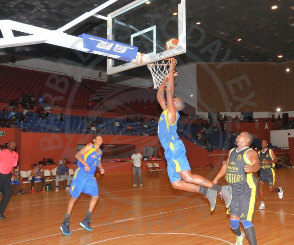 Barbados Lumber Company Lakers power forward John Jones top scored with 20 points for his team while Chiamaka Browne (left) had the second best figures of 17 during game three against Barbados Hilton Resort Warriors. (Pictures by Morissa Lindsay)