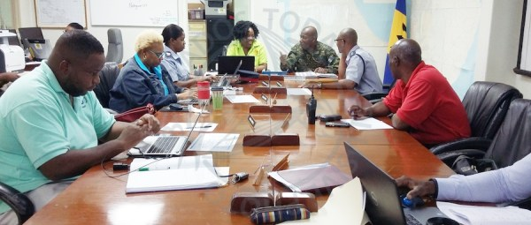 Key representatives of the National Emergency Operations Centre (NEOC) in session today at the Department of Emergency Management (DEM) in Warrens, St Michael discussing the island's response to the passage of tropical storm Kirk.