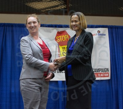 CEO of Heart and Stroke Foundation of Barbados Inc. Fiona Anthony (left) presented Director of Heart and Stroke Foundation Professor Margaret Anne St John with a designation of Chief Champion at the Childhood Obesity Conference.