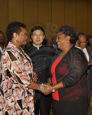 Prime Minister Mia Mottley (right) greets Governor General Dame Sandra Mason as China's Ambassador to Barbados Yan Xiusheng looks on.