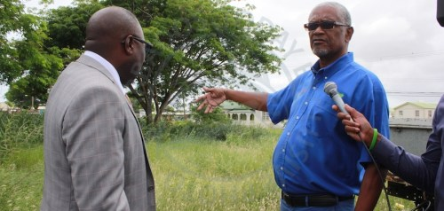 From left, Minister of Small Business, Entrepreneurship and Commerce Dwight Sutherland looks on as Carlton and A1 Supermarket owner Andrew Bynoe identify the site for the new shopping mall.